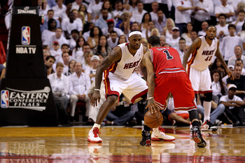 MIAMI, FL - MAY 24:  LeBron James #6 of the Miami Heat defends Derrick Rose #1 of the Chicago Bulls in Game Four of the Eastern Conference Finals during the 2011 NBA Playoffs on May 24, 2011 at American Airlines Arena in Miami, Florida. The Heat won 101-9