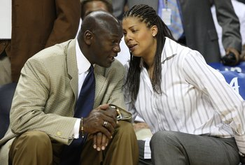CHARLOTTE - APRIL 24:  Charlotte Bobcats owner Michael Jordan talks with sideline reporter Cheryl Miller during Game Three of the Eastern Conference Quarterfinals between the Orlando Magic and the Charlotte Bobcats during the 2010 NBA Playoffs at Time War
