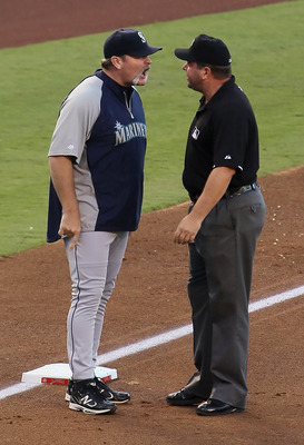 ANAHEIM, CA - JULY 09:  Seattle Mariners manager Eric Wedge argues with third base umpire Sam Holbrook before being ejected in the third inning against the Los Angeles Angels of Anaheim at Angel Stadium of Anaheim on July 9, 2011 in Anaheim, California. T