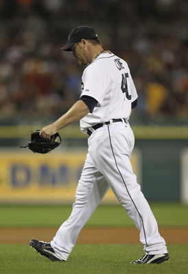DETROIT - AUGUST 03: Phil Coke #40 of the Detroit Tigers walks to the dugout after pitching to one batter in the eight inning of the game against the Texas Rangers at Comerica Park on August 3, 2011 in Detroit, Michigan. The Tigers defeated the Rangers 5-