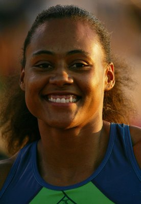 INDIANAPOLIS - JUNE 23:  Marion Jones is smiles after winning the 100 meter dash final on day two of the AT&T USA Outdoor Track and Field Championships at Indiana University Track and Field Stadium on June 23, 2006 in Indianapolis, Indiana.  (Photo by Mat