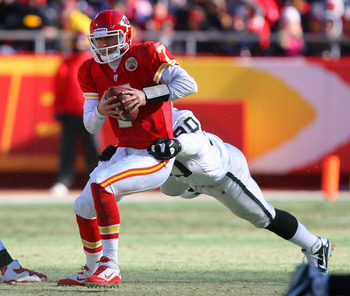 KANSAS CITY, MO - JANUARY 02:  Quarterback Matt Cassel #7 of the Kansas City Chiefs is tackled from behind by defensive tackle Desmond Bryant #90 of the Oakland Raiders in a game at Arrowhead Stadium on January 2, 2011 in Kansas City, Missouri.  (Photo by
