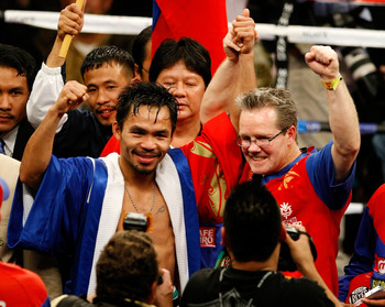 LAS VEGAS - DECEMBER 06:  (L-R) Manny Pacquiao of the Philippines celebrates with his trainer Freddie Roach after defeating Oscar De La Hoya in their welterweight fight at the MGM Grand Garden Arena December 6, 2008 in Las Vegas, Nevada.  (Photo by Ethan