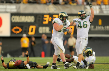 BOULDER, CO - SEPTEMBER 06:  Nose guard Guy Miller #66 of the Colorado State Rams celebrates his sack of quarterback Cody Hawkins #7 (L) of the Colorado Buffaloes with teammate Ty Whittier #47 at Folsom Field on September 6, 2009 in Boulder, Colorado.  (P
