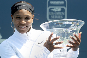 STANFORD, CA - JULY 31:  Serena Williams poses for photographers after her win over Marion Bartoli of France during the final of the Bank of the West Classic at the Taube Family Tennis Stadium on July 31, 2011 in Stanford, California.  (Photo by Matthew S