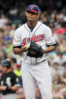 CLEVELAND, OH - JULY 22: Starting pitcher Carlos Carrasco #59 of the Cleveland Indians reacts after hitting a bater during the second inning against the Chicago White Sox at Progressive Field on July 22, 2011 in Cleveland, Ohio. (Photo by Jason Miller/Get