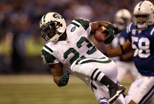 INDIANAPOLIS, IN - JANUARY 08:  Shonn Greene #23 of the New York Jets runs the ball against the Indianapolis Colts during their 2011 AFC wild card playoff game at Lucas Oil Stadium on January 8, 2011 in Indianapolis, Indiana. The Jets won 17-16.  (Photo b