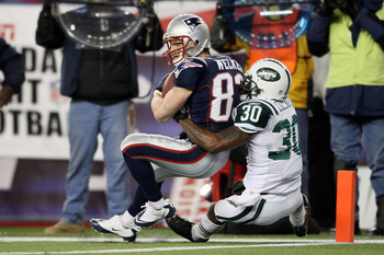 FOXBORO, MA - DECEMBER 06:  Wes Welker #83 of the New England Patriots scores an 18-yard touchdown reception in the third quarter against Drew Coleman #30 of the New York Jets at Gillette Stadium on December 6, 2010 in Foxboro, Massachusetts.  (Photo by E