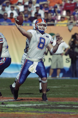 TAMPA, FL - JANUARY 1:  Quarterback Rex Grossman #8 of the Florida Gators throws a pass against the Michigan Wolverines during the Outback Bowl at Raymond James Stadium on January 1, 2003 in Tampa, Florida.  The Wolverines defeated the Gators 38-30.  (Pho