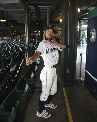 SEATTLE - AUGUST 03:  Kenta Imamura, an Ichiro Suzuki impersonator, strikes Suzuki's famous batting pose in the stands prior to the game between the Seattle Mariners and the Oakland Athletics at Safeco Field on August 3, 2011 in Seattle, Washington. (Phot
