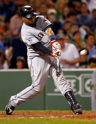 BOSTON, MA - AUGUST 4:  Carlos Santana #41 of the Cleveland Indians hits a two-run home run against the Boston Red Sox in the sixth at Fenway Park on August 4, 2011 in Boston, Massachusetts.  (Photo by Jim Rogash/Getty Images)
