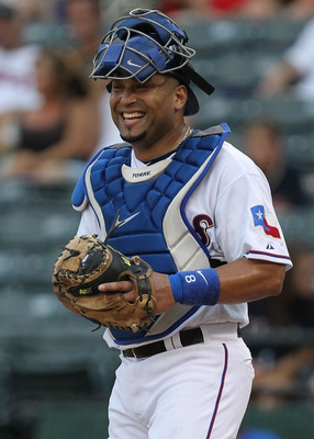 ARLINGTON, TX - JULY 28:  Yorvit Torrealba #8 of the Texas Rangers at Rangers Ballpark in Arlington on July 28, 2011 in Arlington, Texas.  (Photo by Ronald Martinez/Getty Images)