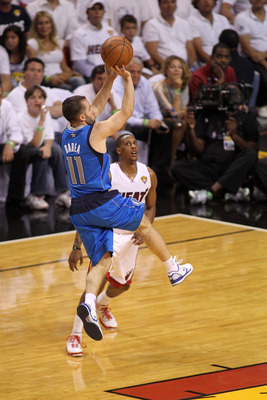 MIAMI, FL - JUNE 12:  Jose Juan Barea #11 of the Dallas Mavericks attempts a shot against Mario Chalmers #15 of the Miami Heat in Game Six of the 2011 NBA Finals at American Airlines Arena on June 12, 2011 in Miami, Florida. NOTE TO USER: User expressly a