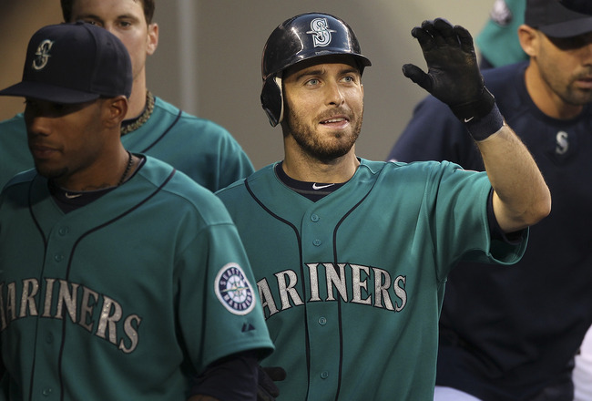 SEATTLE - AUGUST 01:  Dustin Ackley #13 of the Seattle Mariners is congratulated by teammates after scoring on a single by Miguel Olivo against the Oakland Athletics at Safeco Field on August 1, 2011 in Seattle, Washington. (Photo by Otto Greule Jr/Getty
