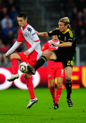 UTRECHT, NETHERLANDS - SEPTEMBER 30:  Christian Poulson of Liverpool battles with Ricky Van Wolfswinkle of FC Utrecht during the UEFA Europa League match between FC Utrecht and Liverpool at the Stadion Galgenwaard on September 30, 2010 in Utrecht, Netherl
