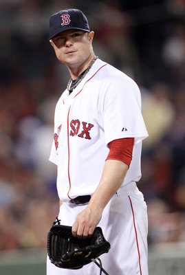 BOSTON, MA - JULY 25: Jon Lester #31 of the Boston Red Sox heads into the dugout in the sixth inning against the Kansas City Royals on July 25, 2011 at Fenway Park in Boston, Massachusetts.  (Photo by Elsa/Getty Images)