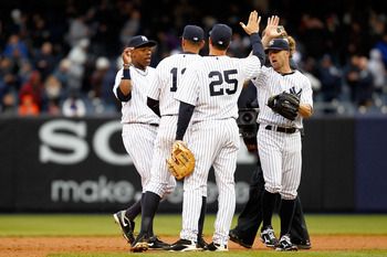 NEW YORK, NY - MARCH 31:  Curtis Granderson #14, Alex Rodriguez #13, Mark Teixeira #25 and Brett Gardner #11 of the New York Yankees celebrate their 6-3 win over the Detroit Tigers on Opening Day at Yankee Stadium on March 31, 2011 in the Bronx borough of