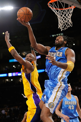 LOS ANGELES, CA - MAY 27:  Nene #31 of the Denver Nuggets goes up for a shot against Lamar Odom #7 of the Los Angeles Lakers in Game Five of the Western Conference Finals during the 2009 NBA Playoffs at Staples Center on May 27, 2009 in Los Angeles, Calif