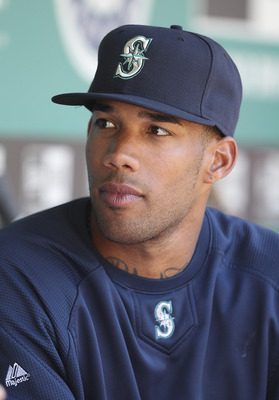 SEATTLE - JUNE 03:  Outfielder Greg Halman #56 of the Seattle Mariners listens to third base coach Jeff Datz go over the signs prior to the game against the Tampa Bay Rays at Safeco Field on June 3, 2011 in Seattle, Washington. Halman  was recalled from t
