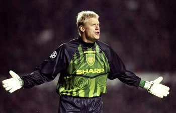 22 Oct 1997:  Manchester United goalkeeper Peter Schmeichel holds out his hands during a European Champions League match against Feyenoord at Old Trafford in Manchester, England. Manchester United won the match 2-1. \ Mandatory Credit: Shaun  Botterill/Al