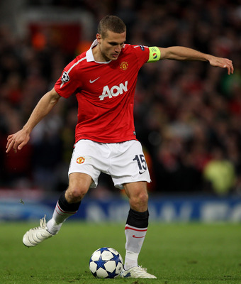 MANCHESTER, ENGLAND - APRIL 12:   Nemanja Vidic of Manchester United in action during the UEFA Champions League Quarter Final second leg match between Manchester United and Chelsea at Old Trafford on April 12, 2011 in Manchester, England.  (Photo by Alex