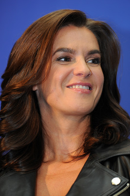 DURBAN, SOUTH AFRICA - JULY 04:  Chair of the Munich 2018 Bid Committee and two-time Olympic champion Katarina Witt smiles as she speaks to the media during a press conference on July 4, 2011 in Durban, South Africa. The annual general meeting of the memb