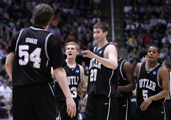 SALT LAKE CITY - MARCH 25:  (L-R) Matt Howard #54, Zach Hahn #3, Gordon Hayward #20 and Ronald Nored #5 of the Butler Bulldogs celebrate after scoring against the Syracuse Orange during the west regional semifinal of the 2010 NCAA men's basketball tournam