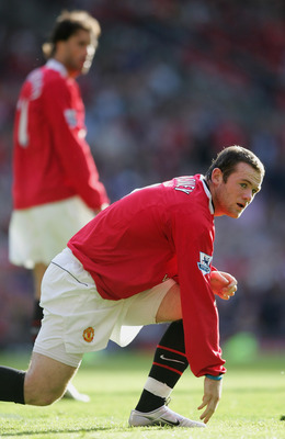 MANCHESTER, UNITED KINGDOM - SEPTEMBER 24:  Wayne Rooney and Ruud Van Nistelrooy of Manchester during the Barclays Premiership match between Manchester United and Blackburn Rovers at Old Trafford on 24 September 2005, in Manchester England.  (Photo by Ros