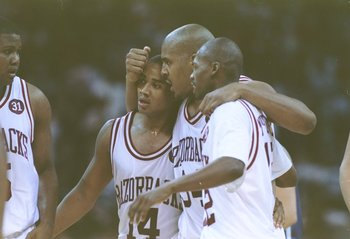 4 Apr 1994:  Several Arkansas Razorbacks players celebrate after a game against the Duke Blue Devils.  Arkansas won the game, 76-72. Mandatory Credit: Doug Pensinger  /Allsport