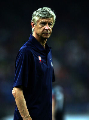 KUALA LUMPUR, MALAYSIA - JULY 13: Arsenal Coach Arsene Wenger during the pre-season Asian Tour friendly match between Malaysia and Arsenal at Bukit Jalil National Stadium on July 13, 2011 in Kuala Lumpur, Malaysia.  (Photo by Stanley Chou/Getty Images)