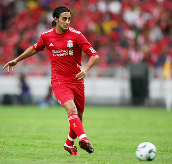 KUALA LUMPUR, MALAYSIA - JULY 16: Alberto Aquilani of Liverpool kicks during the pre-season friendly between Malaysia and Liverpool at the Bukit Jalil National Stadium on July 16, 2011 in Kuala Lumpur, Malaysia. (Photo by Stanley Chou/Getty Images)