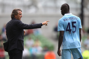 DUBLIN, IRELAND - JULY 31:  Roberto Mancini, the Manchester City manager issues instructions to Mario Balotelli during the Dublin Super Cup match between Inter Milan and Manchester City at the Aviva Stadium on July 31, 2011 in Dublin, Ireland.  (Photo by