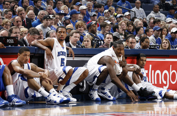MEMPHIS, TN - MARCH 15: Derrick Rose #23, Antonio Anderson #5, Joey Dorsey #3 and Chris Douglas-Roberts #14 of the Memphis Tigers wait to check in against the Tulsa Golden Hurricane during the finals of the Conference USA Basketball Tournament at FedExFor