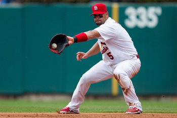 ST. LOUIS, MO - JULY 30: Albert Pujols #5 of the St. Louis Cardinals fields a one hopper against the Chicago Cubs at Busch Stadium on July 30, 2011 in St. Louis, Missouri.  (Photo by Dilip Vishwanat/Getty Images)