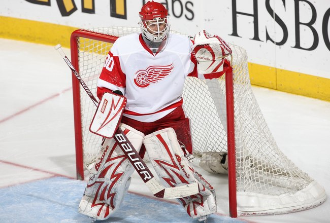 CALGARY, CANADA - OCTOBER 31: Goaltender Chris Osgood #30 of the Detroit Red Wings defends his net against the Calgary Flames during their game on October 31, 2009 at the Pengrowth Saddledome in Calgary, Alberta, Canada. The Red Wings defeated the Flames