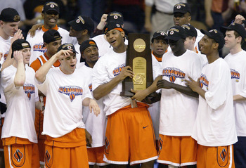NEW ORLEANS - APRIL 7:  Carmelo Anthony #15 and the rest of the Syracuse team celebrate with the championship trophy after defeating Kansas 81-78 during the championship game of the NCAA Men's Final Four Tournament on April 7, 2003 at the Louisiana Superd