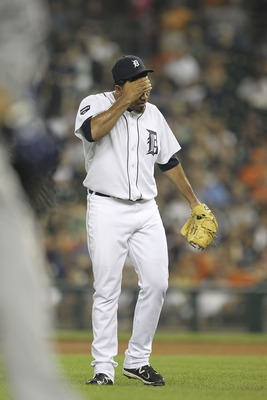 DETROIT - AUGUST 02: Joaquin Benoit #53 of the Detroit Tigers reacts after Nelson Cruz #17 of the Texas Rangers hits a solo home in the eight inning during the game at Comerica Park on August 2, 2011 in Detroit, Michigan.  (Photo by Leon Halip/Getty Image
