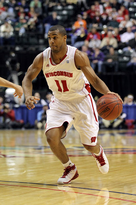 INDIANAPOLIS, IN - MARCH 11:  Jordan Taylor #11 of the Wisconsin Badgers drives against the Penn State Nittany Lions during the quarterfinals of the 2011 Big Ten Men's Basketball Tournament at Conseco Fieldhouse on March 11, 2011 in Indianapolis, Indiana.