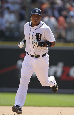 DETROIT - JULY 31: Carlos Guillen #9 of the Detroit Tigers hits a solo home run in the seventh inning during the game against the Los Angeles Angels of Aneheim at Comerica Park on July 31, 2011 in Detroit, Michigan.  (Photo by Leon Halip/Getty Images)