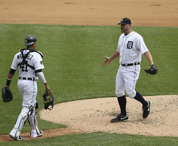 DETROIT - JULY 28:  Brad Penny #31 and Victor Martinez #41 of the Detroit Tigers have a verbal confrontation on the mound after Mark Trumbo #44 of the Los Angeles Angeles of Anaheim hit a run scoring triple during the game at Comerica Park on July 28, 201