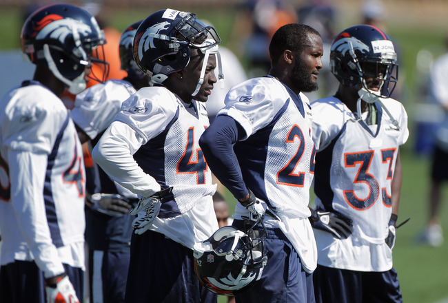 ENGLEWOOD, CO - JULY 28:  (L-R) Defensive backs Kyle McCarthy #34, Cassius Vaughn #41, Champ Bailey #24 and Nate Jones #33 of the Denver Broncos takes part in training camp at the Paul D. Bowlen Memorial Broncos Centre at Dove Valley on July 28, 2011 in E