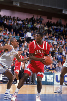 1990:  Larry Johnson #4 of the University of Las Vegas Nevada Rebels looks to move the ball during an NCAA game against UC Irvine Anteaters in 1990.  (Photo by Ken Levine/Getty Images)