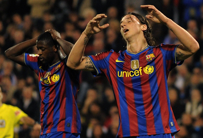 ZARAGOZA, SPAIN - MARCH 21: Zlatan Ibrahimovic (R) and Toure Yaya of Barcelona react during the La Liga match between Real Zaragoza and Barcelona at La Romareda stadium on March 21, 2010 in Zaragoza, Spain.  (Photo by Denis Doyle/Getty Images)