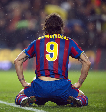 BARCELONA, SPAIN - JANUARY 16: Zlatan Ibrahimovic of FC Barcelona sits on the pitch after failing to score during the La Liga match between Barcelona and Sevilla at the Camp Nou stadium on January 16, 2010 in Barcelona, Spain. Barcelona won 4-0. (Photo by