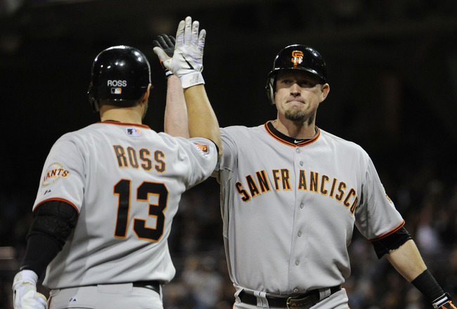 SAN DIEGO, CA - JULY 14: Aubrey Huff #17 of the San Francisco Giants is congratulated by teammate Cody Ross #13 after Huff hit a solo home run during the ninth inning of a baseball game against the San Diego Padres at Petco Park on July 14, 2011 in San Di