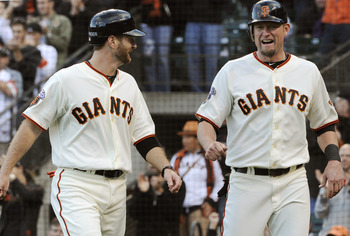 SAN FRANCISCO, CA - JULY 23: Aubrey Huff #17 and Jeff Keppinger #8 of the San Francisco Giants celebrate after scoring on a two run single by Nate Schierholtz #12 against the Milwaukee Brewers in the fourth inning during an MLB baseball game at AT&T Park