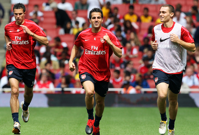 LONDON, ENGLAND - AUGUST 05:  (l to r) Robin Van Persie, Cesc Fabregas and Thomas Vermaelen attend an Arsenal open training session at Emirates Stadium on August 5, 2010 in London, England.  (Photo by Bryn Lennon/Getty Images)