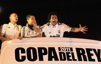 BARCELONA, SPAIN - APRIL 21:  (L-R)  Pepe, Cristiano Ronaldo and Marcelo of Real Madrid celebrate on an open bus at Plaza Cibeles on April 21, 2011 in Madrid, Spain after Real beat Barcelona 1-0 in the Copa del Rey final in Valencia's Mestalla stadium on