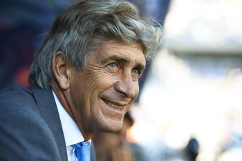 MALAGA, VALENCIA - MAY 21:  Head Coach Manuel Pellegrini of Malaga smiles before the La Liga match between Malaga and Barcelona at La Rosaleda Stadium on May 21, 2011 in Malaga, Spain. Barcelona won 3-1.  (Photo by Manuel Queimadelos Alonso/Getty Images)