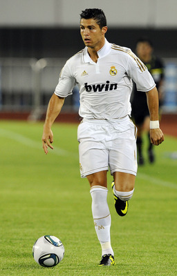 GUANGZHOU, CHINA - AUGUST 03:  Cristiano Ronaldo of Real Madrid in action during the pre-season friendly match between Guangzhou Evergrande and Real Madrid at the Tianhe Stadium on August 3, 2011 in Guangzhou, China. (Photo by Victor Fraile/Getty Images)